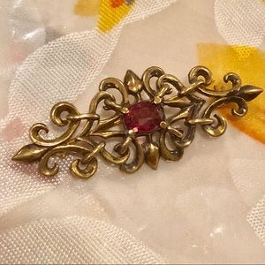 Sterling gold plated pin w/ pink stone